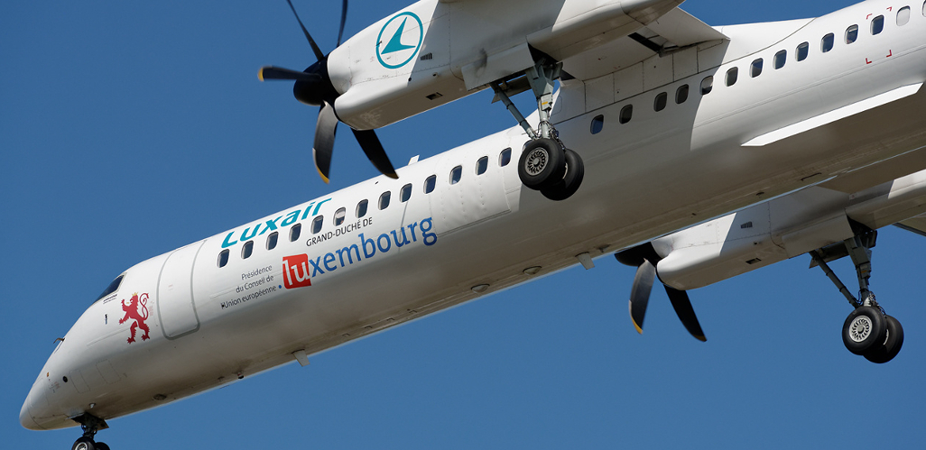 Illustration for: Luxair branded Bombardier Q400 fleet in Luxembourg Presidency livery with BCO Aviation
