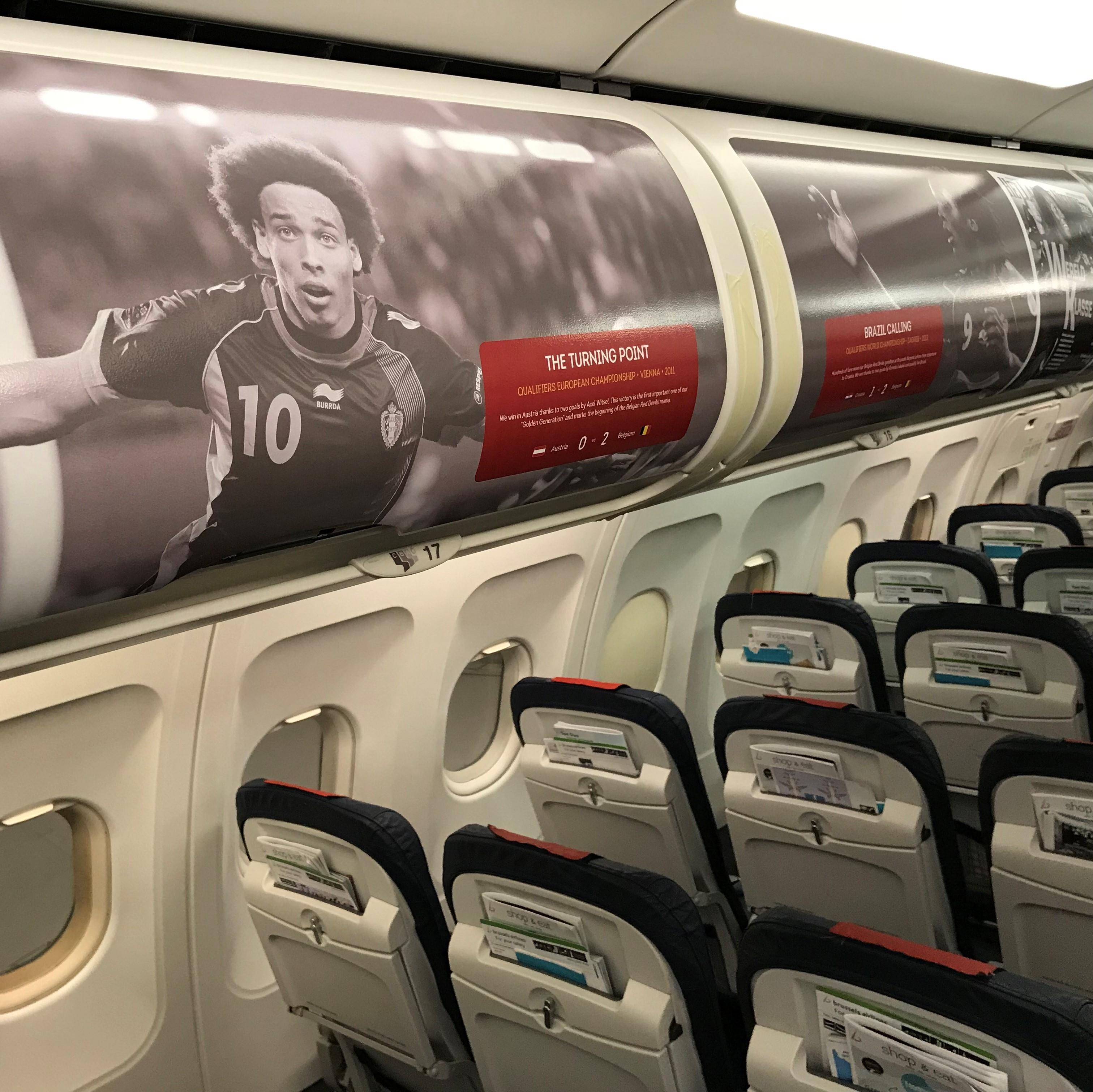 Illustration of: Belgian Red Devils overhead bins for Brussels Airlines