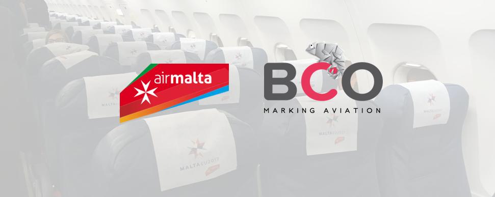 Illustration for: Air Malta's headrest covers (antimacassars) for in plane's advertising