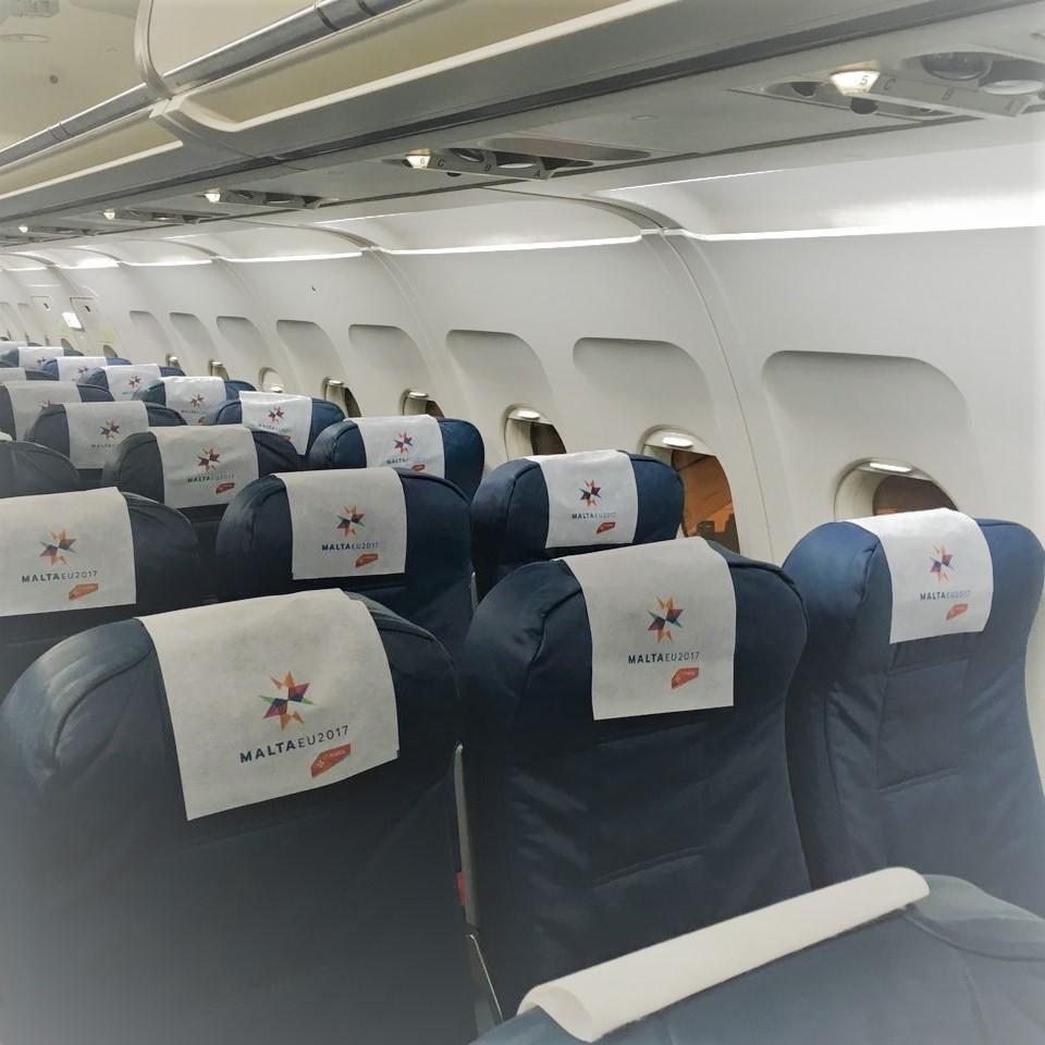 Illustration of: Air Malta's headrest covers (antimacassars) for in plane's advertising