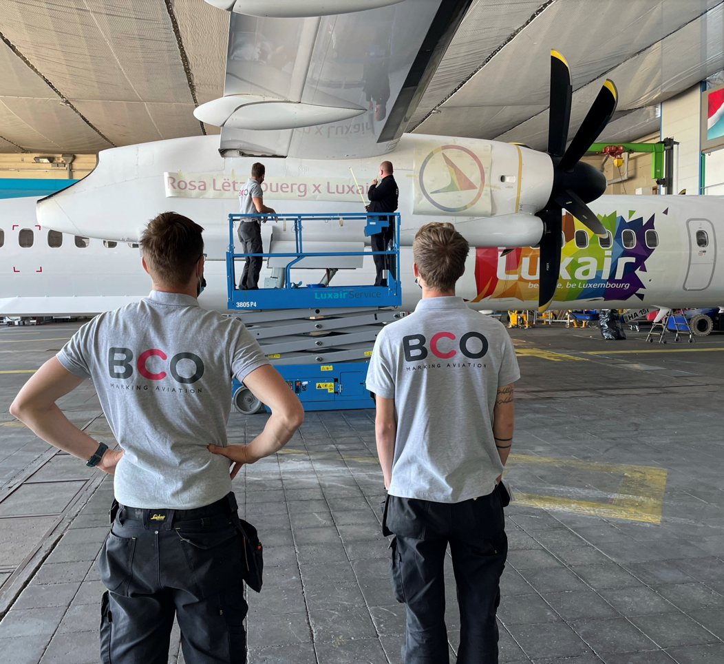 Illustration of: We installed a colourful new aircraft livery on De Havilland Q400 for Luxair Airlines (Video)